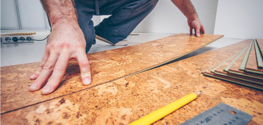 worker connecting cork flooring panels