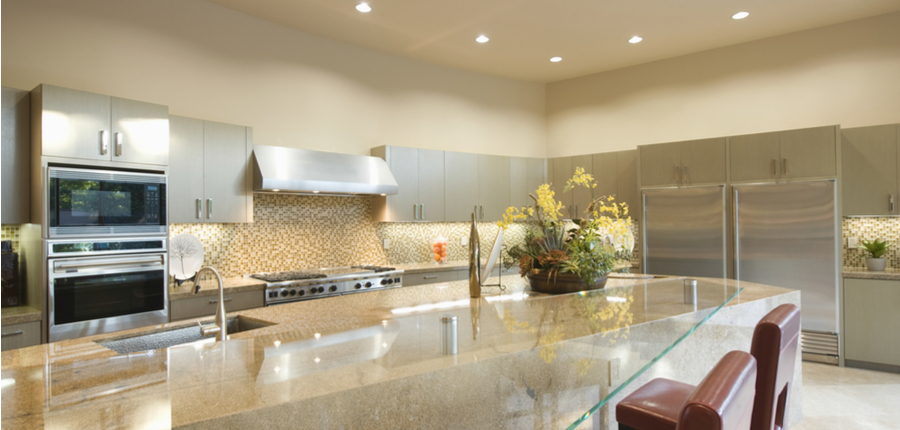 a kitchen in home with recessed lighting roof