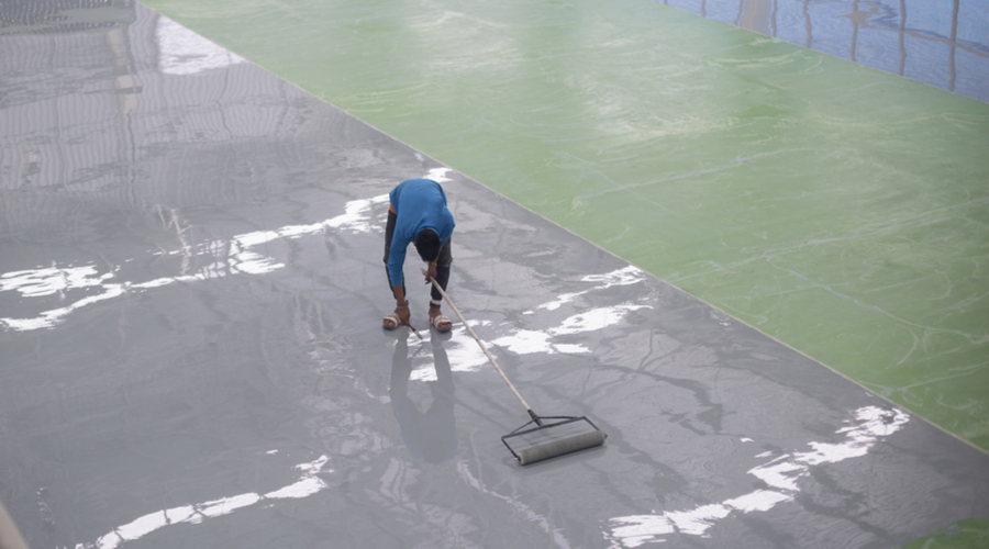 Worker applying epoxy floor