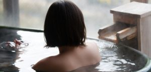 women enjoys hot spring bath