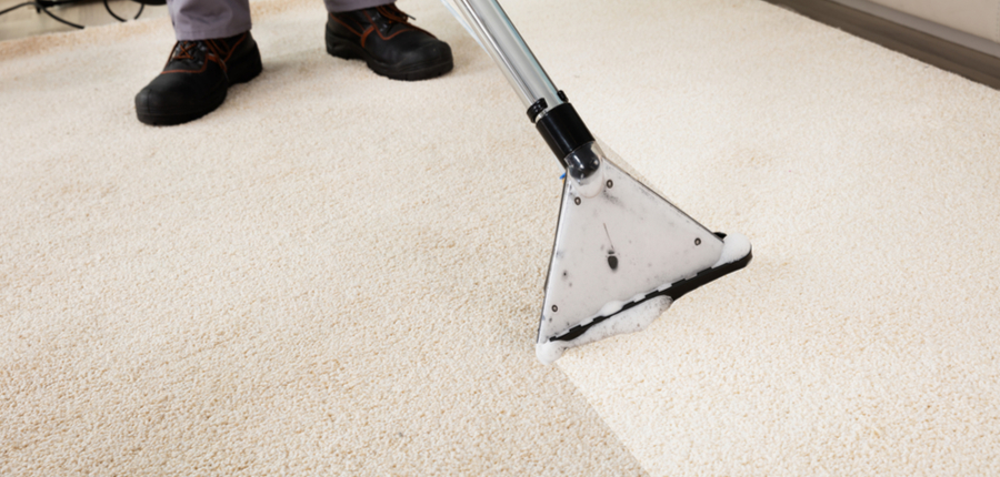 cleaning of carpet with vacuum cleaner