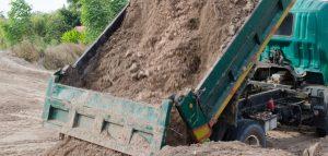 dump trucks carrying fill dirt
