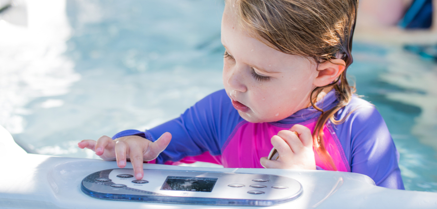 cute girl playing in jacuzzi controls
