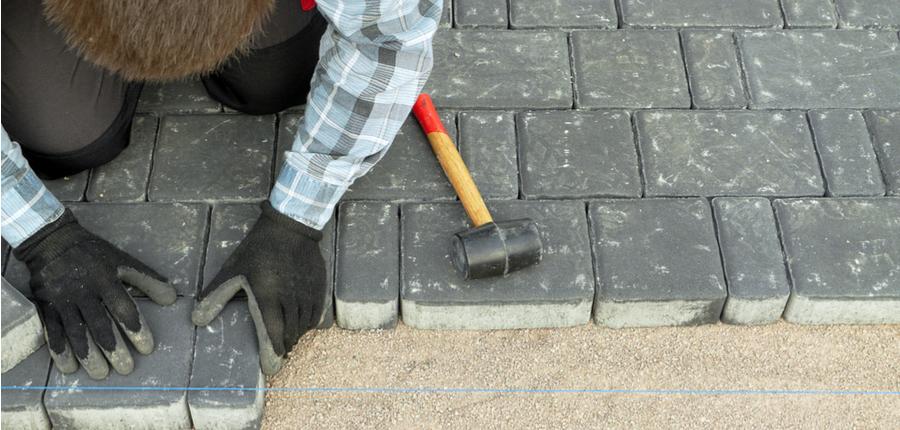 paver laying driveway pavement